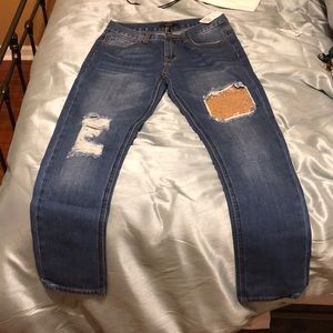 Jeans with rip and sequin designs